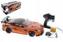 Auto RC oranžové zrychlující plast 40cm 27MHz na baterie + dobíjecí pack