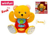 Medvídek 18 cm sedící na baterie se světlem a zvukem